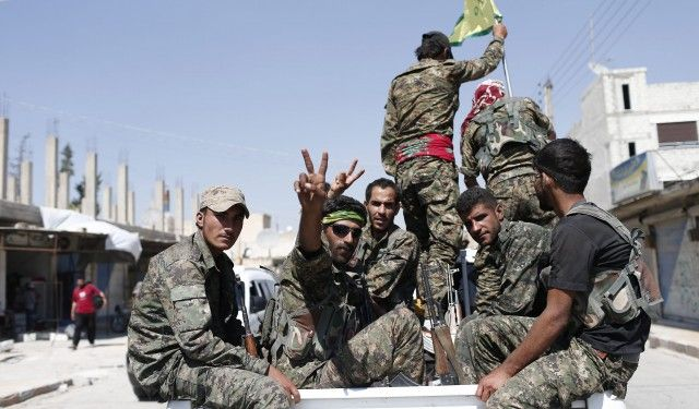 epa05620115 (FILE) A file photograph dated 23 June 2015 showing members of Kurdish People Defence Units (YPG) flashing victory sign after coming from Syrian town of al-Raqqa, in Tel Abyad, Syria. Reports state the Syrian Democratic Forces (SDF) announced on 06 November 2016 that it had started a military campaign to liberate the northern Syrian city of Raqqa, the main stronghold of the Islamic State militant group in Syria. SDF is an umbrella group gathering Kurdish and Arab rebels fighting in Syria.  EPA/SEDAT SUNA
