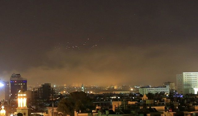 Damascus skies erupt with anti-aircraft fire and smoke as the U.S. launches an attack on Syria targeting different parts of the Syrian capital Damascus, early Saturday, April 14, 2018. Damascus has been rocked by loud explosions that lit up the sky with heavy smoke as U.S. President Donald Trump announced airstrikes in retaliation for the country's alleged use of chemical weapons. (AP Photo/Hassan Ammar)